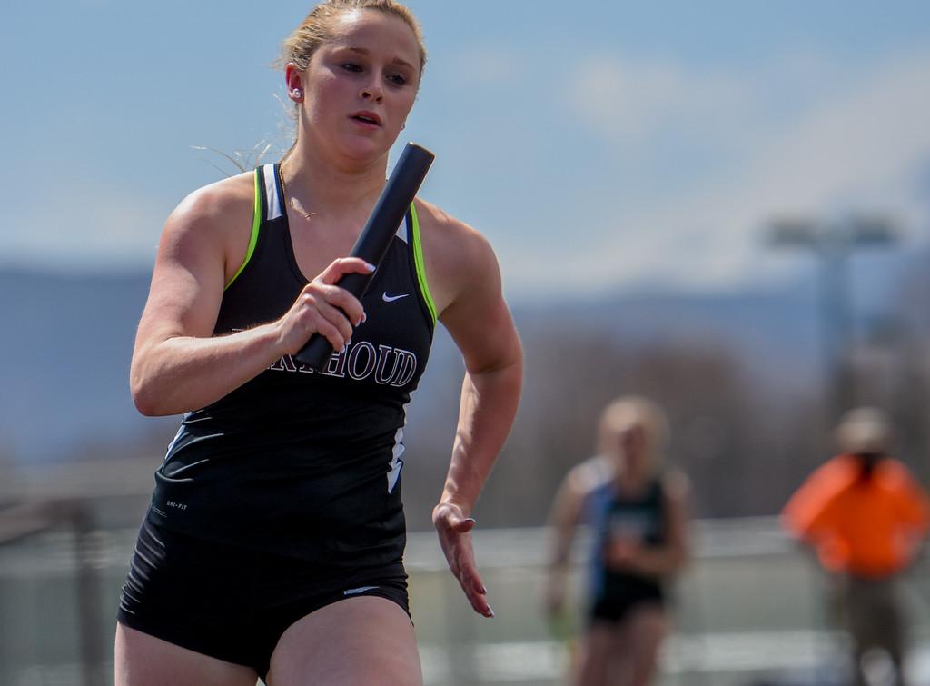 . Berthoud\'s Alyssa Bailey runs her leg of the 800-meter relay during the R2J Meet on Thursday April 12, 2018 at LHS. (Cris Tiller / Loveland Reporter-Herald)