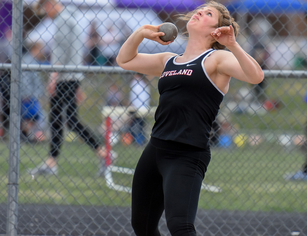 . Loveland\'s Moira Dillow throws the shot put for a win in the event during the R2J Meet on Thursday April 12, 2018 at LHS. (Cris Tiller / Loveland Reporter-Herald)