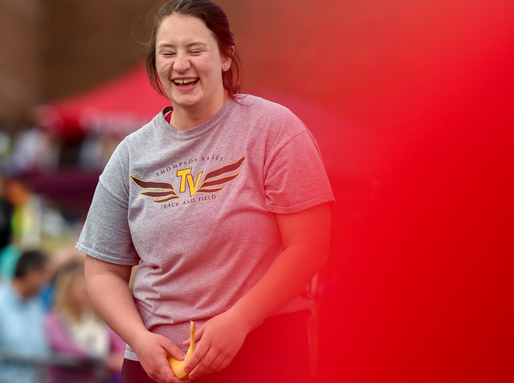 . Thompson Valley\'s JoAnne Ward laughs before the exhibition 4x50 meter relay during the R2J Meet on Thursday April 12, 2018 at LHS. (Cris Tiller / Loveland Reporter-Herald)