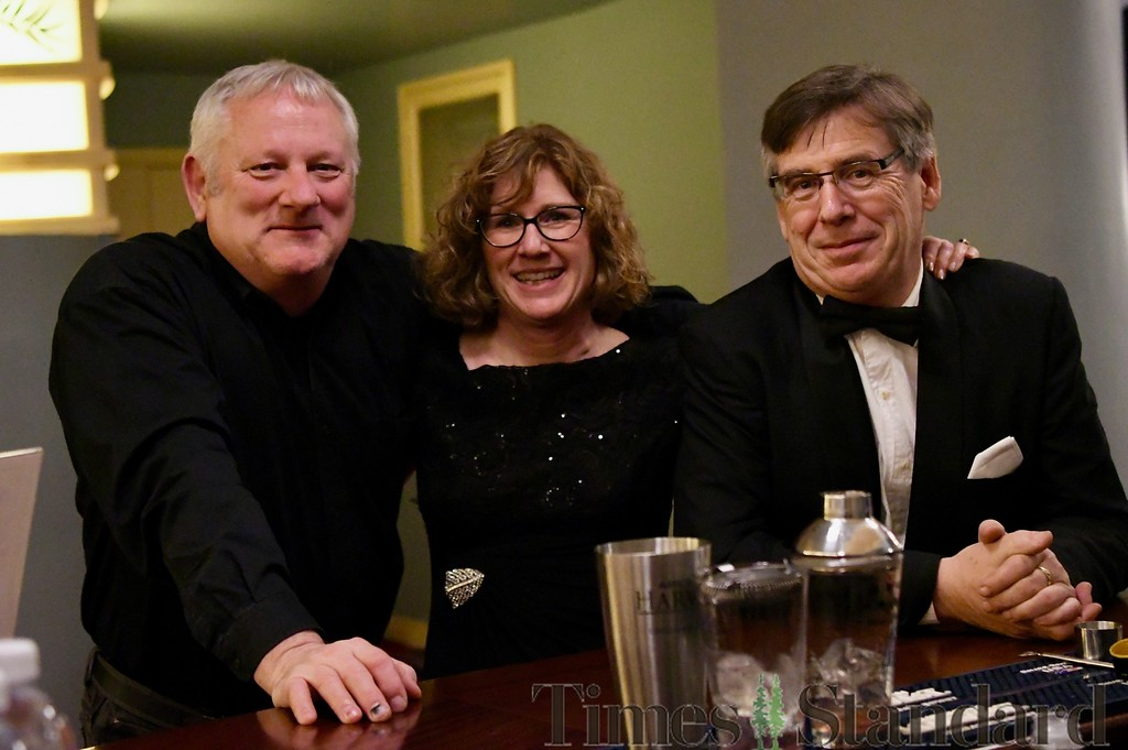 . A friend joins Wendy Petty and Chuck Petty at the bar of the historic Eureka Theater.  José Quezada�For the Times-Standard
