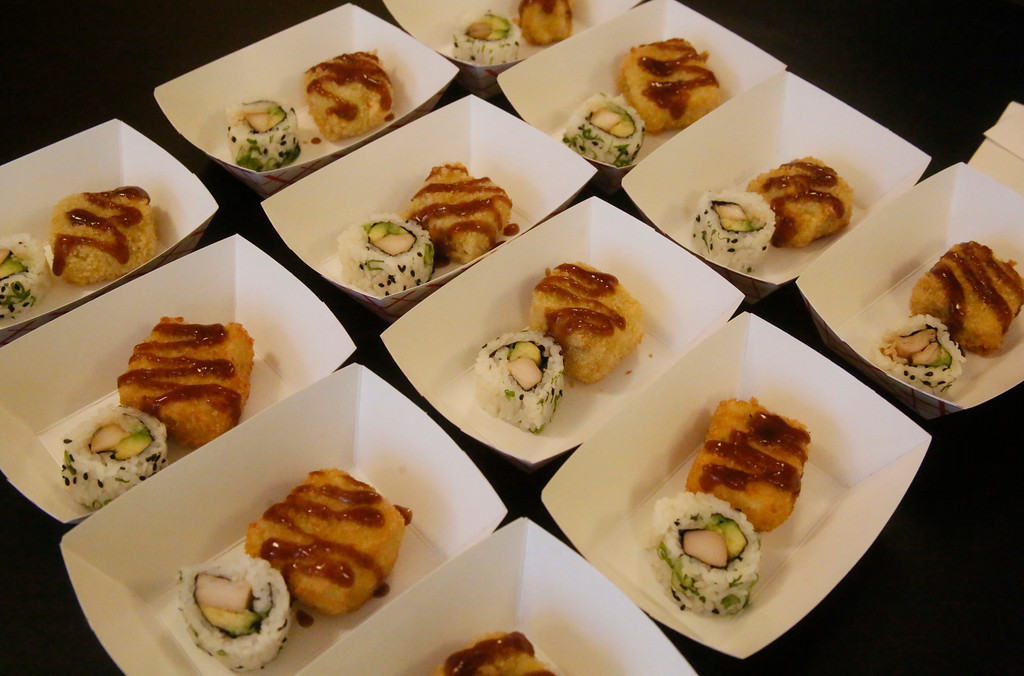 . Shaun Walker � The Times-Standard  Tuna sushi and more awaited attendees at A Taste of Main Street in Eureka on Friday.