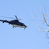 STAN HUDY - SHUDY@DIGITALFIRSTMEDIA.COM<br /> A helicopter circles above the intersetion of Route 50 and Northline Road Saturday afternoon with a police presence below at the Adirondack Trust located at 162 Northline Road in Ballston Spa.