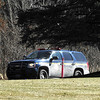 STAN HUDY - SHUDY@DIGITALFIRSTMEDIA.COM<br /> A New York State Police cruiser blocks the entrance to the  Adirondack Trust located at 162 Northline Road in Ballston Spa Saturday afternoon as a helicopter circled the area overhead.