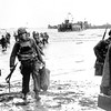 Carrying full equipment, American assault troops move onto a beachhead code-named Omaha Beach, on the northern coast of France on June 6, 1944, during the Allied invasion of the Normandy coast. (AP Photo)