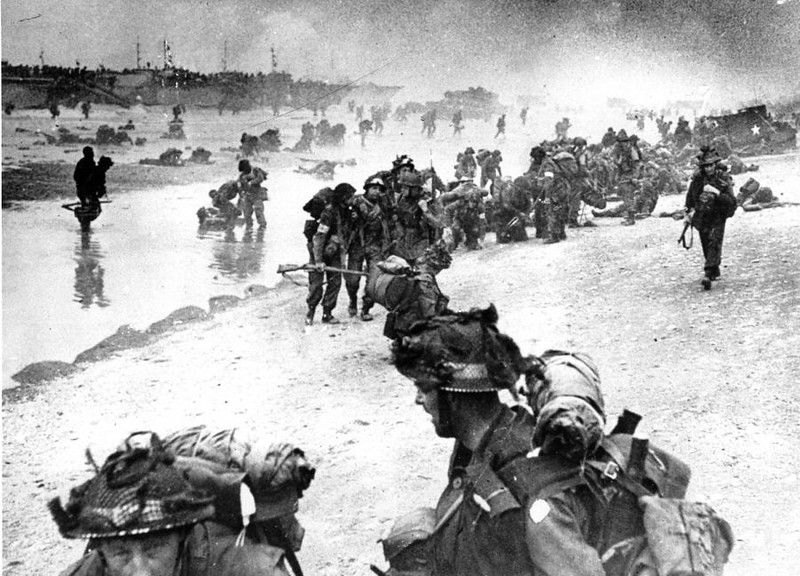 Wounded British troops from the South Lancashire and Middlesex regiments are being helped ashore at Sword Beach, June 6, 1944, during the D-Day invasion of German occupied France during World War II. (AP Photo)