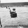 Out of the open bow doors of a Landing Craft, American troops and jeeps go ashore on the beach of the Normandy coast of France, June 6, 1944. (AP Photo)