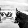 Under heavy German machine gun fire, American infantrymen wade ashore off the ramp of a Coast Guard landing craft on June 8, 1944, during the invasion of the French coast of Normandy in World War II. (AP Photo)