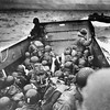 A U.S. Coast Guard landing barge, tightly packed with helmeted soldiers, approaches the shore at Normandy, France, during initial Allied landing operations, June 6, 1944. These barges ride back and forth across the English Channel, bringing wave after wave of reinforcement troops to the Allied beachheads. (AP Photo)