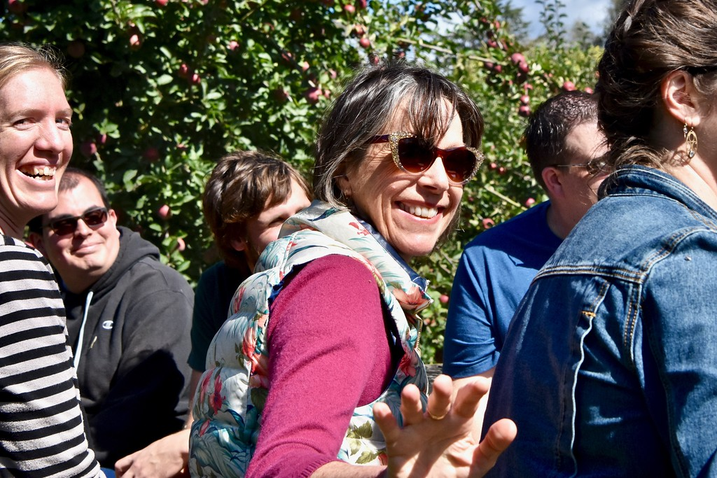 . Holly Hosterman gives a quick wave as she journeys through Clendenen\'s apple orchards. José Quezada�For Times-Standard