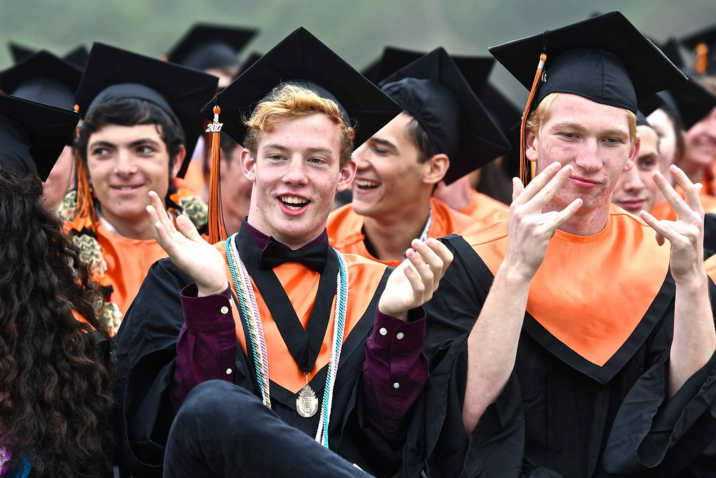 . Students celebrate in their own unique manner during the Arcata high School graduation. (José Quezada�For the Times-Standard)