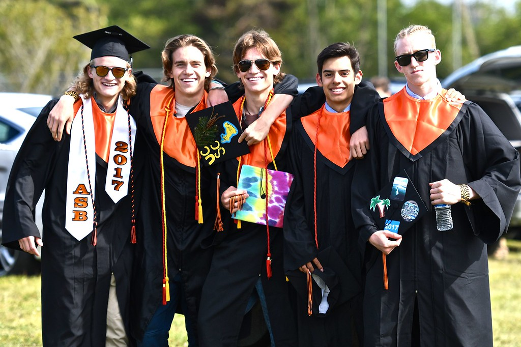 . Five friends mug for the camera before walking from the parking lot join their Arcata High School classmates at the commencement ceremony. (José Quezada�For the Times-Standard)