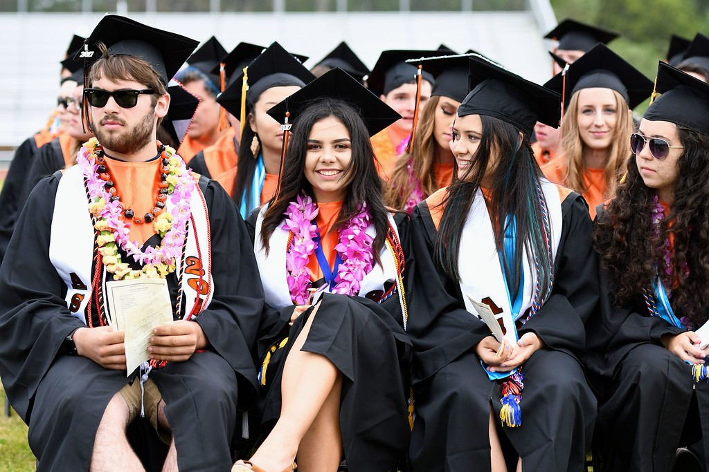. Class speaker Kelsie Sobol, second from left, gets ready to address her fellow Arcata High School graduates. (José Quezada�For the Times-Standard)