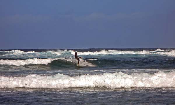 Fuerteventura, El Cotillo, surfing at the vest coast of Fuerteventura, near El Cotillo Lighthouse.