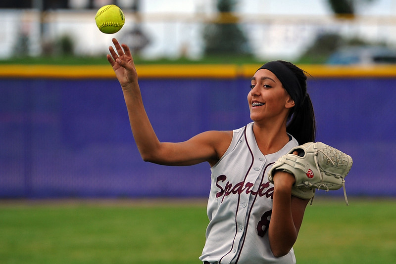 Berthoud's Isabelle Lukensow warms up between innings during a game Tuesday, September, 11, 2018 at Holy Family High School in Broomfield, Colorado. (Sean Star/Loveland Reporter-Herald)