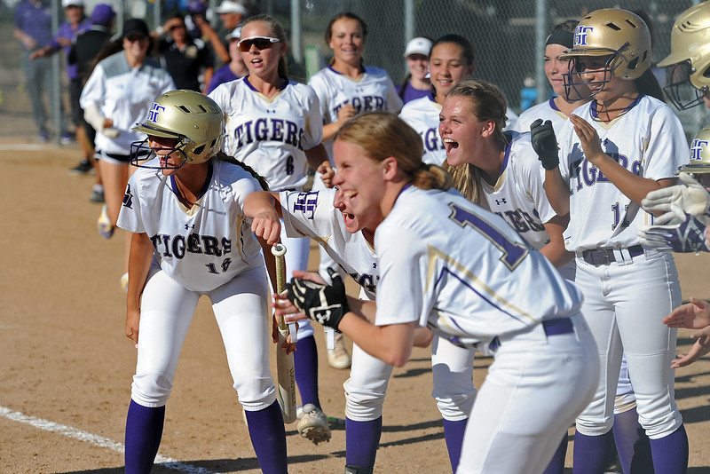 Holy Family teammates wait for Erin Caviness to touch home plate after her home run during a game Tuesday, September, 11, 2018 at Holy Family High School in Broomfield, Colorado. (Sean Star/Loveland Reporter-Herald)