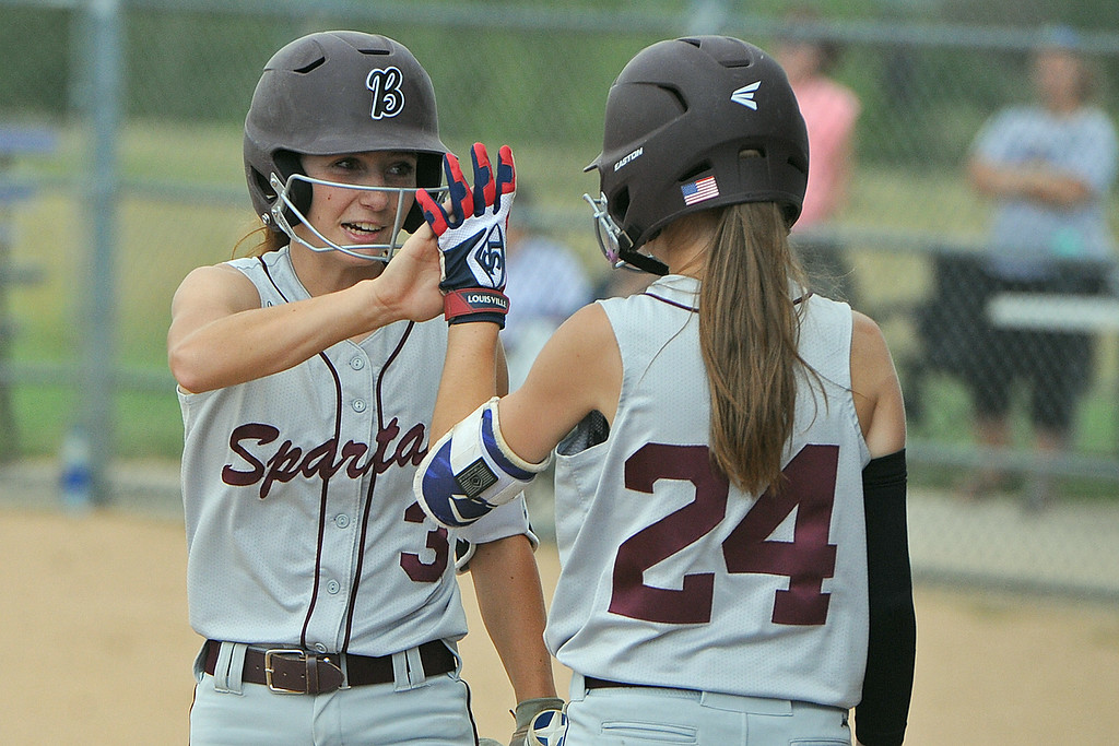 . Berthoud\'s Mandi Laib high-fives Jordan Schachterle (24) during a game Tuesday, September, 11, 2018 at Holy Family High School in Broomfield, Colorado. (Sean Star/Loveland Reporter-Herald)