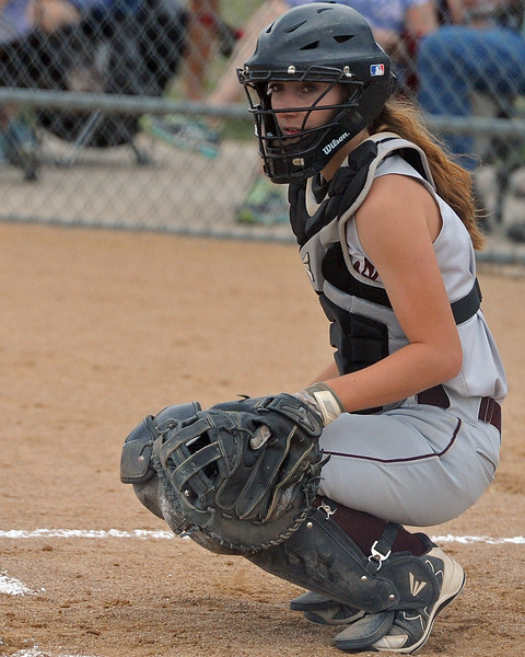 Berthoud catcher Mandi Laib looks to the dugout for a sign during a game Tuesday, September, 11, 2018 at Holy Family High School in Broomfield, Colorado. (Sean Star/Loveland Reporter-Herald)