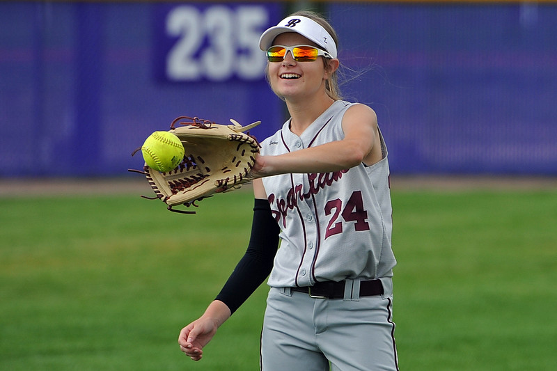 Berthoud's Jordan Schachterle warms up between innings during a game Tuesday, September, 11, 2018 at Holy Family High School in Broomfield, Colorado. (Sean Star/Loveland Reporter-Herald)