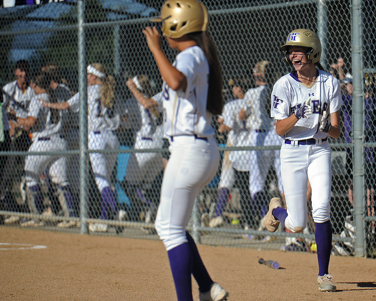 Holy Family's Tyler Whitlock cheers after a home run by teammate Erin Caviness during a game Tuesday, September, 11, 2018 at Holy Family High School in Broomfield, Colorado. (Sean Star/Loveland Reporter-Herald)