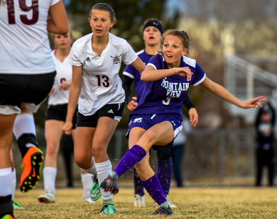 Mountain View's Jacey Paoli, right, strikes on of her two goals against Berthoud on Friday March 23, 2018 at Marr Field in Berthoud. (Cris Tiller / Loveland Reporter-Herald)