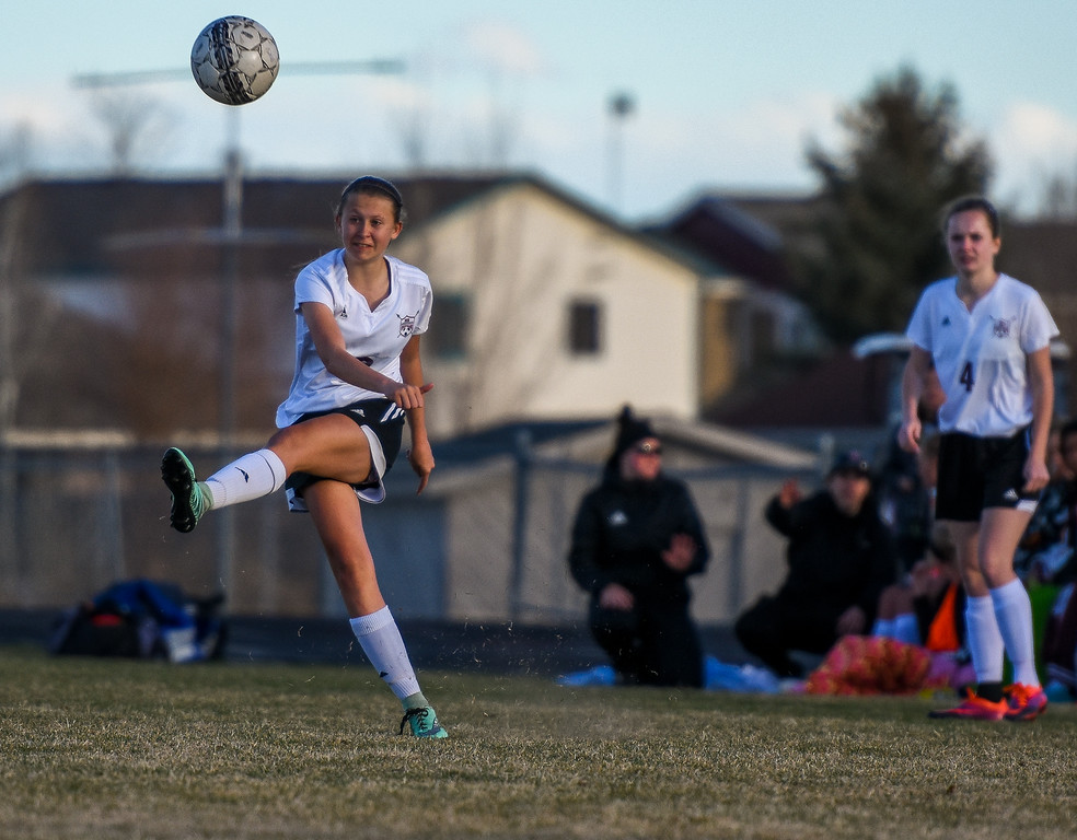 . Berthoud\'s Bre Fowler sends in a free kick against Mountain View on Friday March 23, 2018 at Marr Field in Berthoud. (Cris Tiller / Loveland Reporter-Herald)