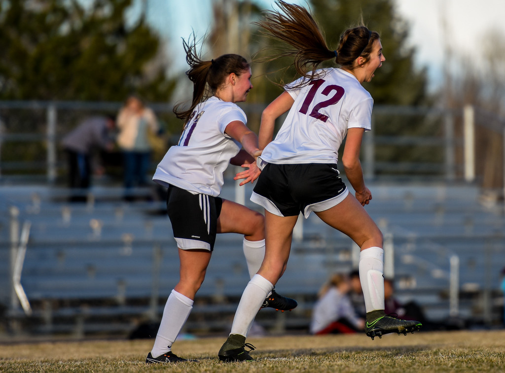 . Berthoud\'s Maddie Barcewski (12) celebrates a goal against Mountain View with teammate Daria Degnan on Friday March 23, 2018 at Marr Field in Berthoud. (Cris Tiller / Loveland Reporter-Herald)