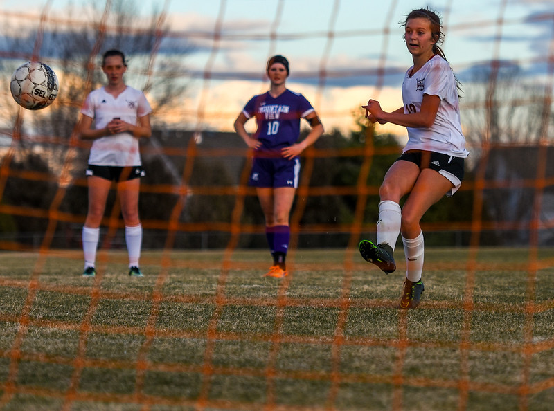 Berthoud's Maddie Barcewski takes a penalty against Mountain View on Friday March 23, 2018 at Marr Field in Berthoud. (Cris Tiller / Loveland Reporter-Herald)