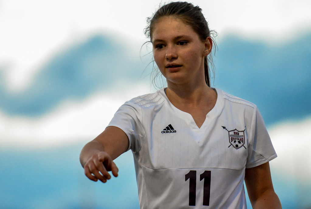 . Berthoud\'s Daria Degnan asks for water against Mountain View on Friday March 23, 2018 at Marr Field in Berthoud. (Cris Tiller / Loveland Reporter-Herald)