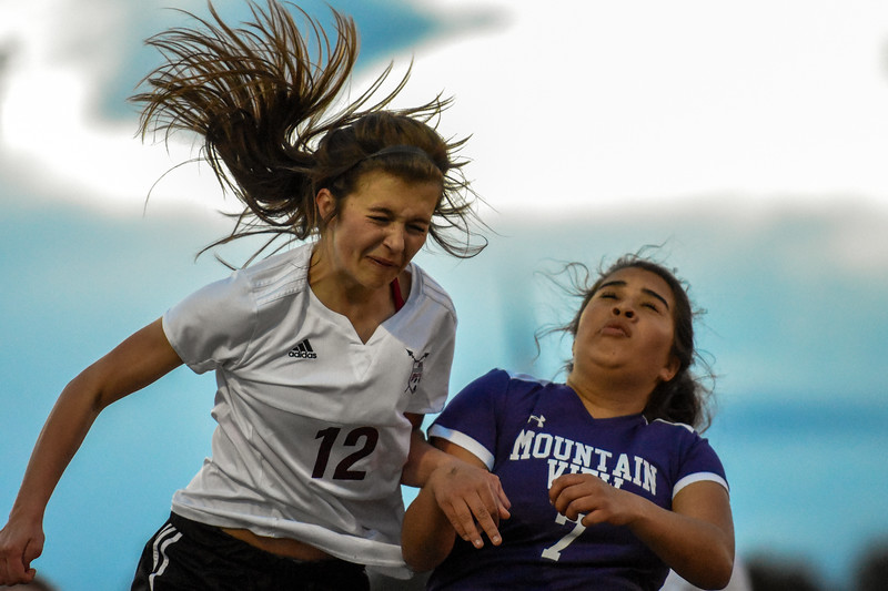 Berthoud's Maddie Barcewski, left, battles for a header with Mountain View's Sarai Castellanos on Friday March 23, 2018 at Marr Field in Berthoud. (Cris Tiller / Loveland Reporter-Herald)