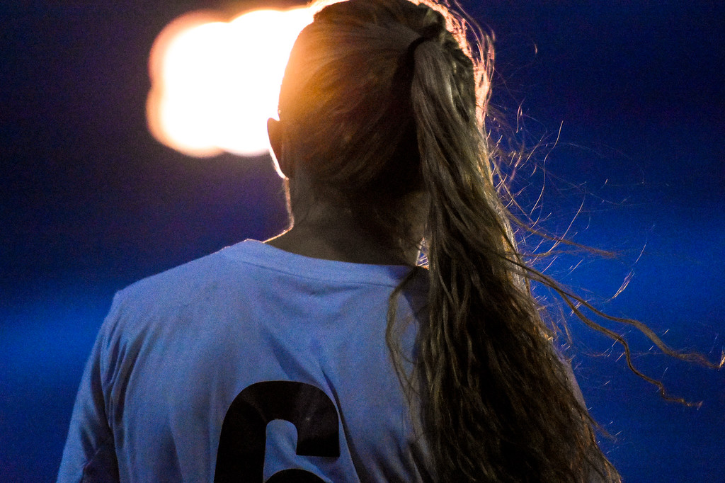 . Berthoud\'s Hailey Pepper waits to sub in against Mountain View on Friday March 23, 2018 at Marr Field in Berthoud. (Cris Tiller / Loveland Reporter-Herald)