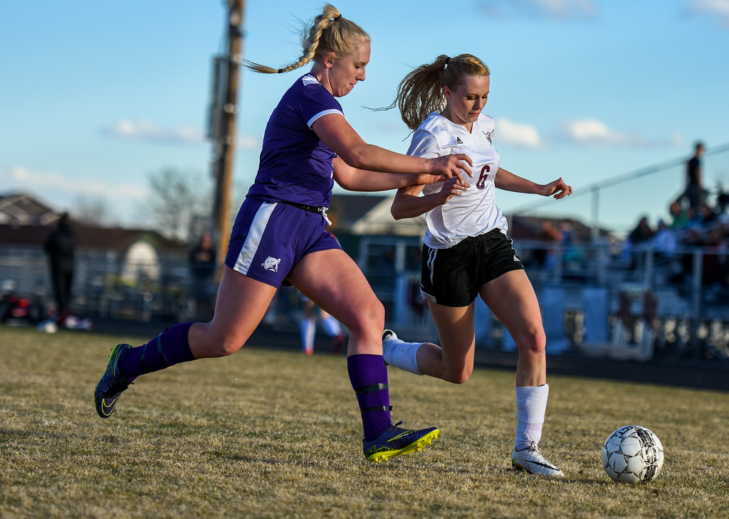 . Berthoud\'s Hailey Pepper (6) dribbles in front of Mountain View defender Ashley McCall on Friday March 23, 2018 at Marr Field in Berthoud. (Cris Tiller / Loveland Reporter-Herald)