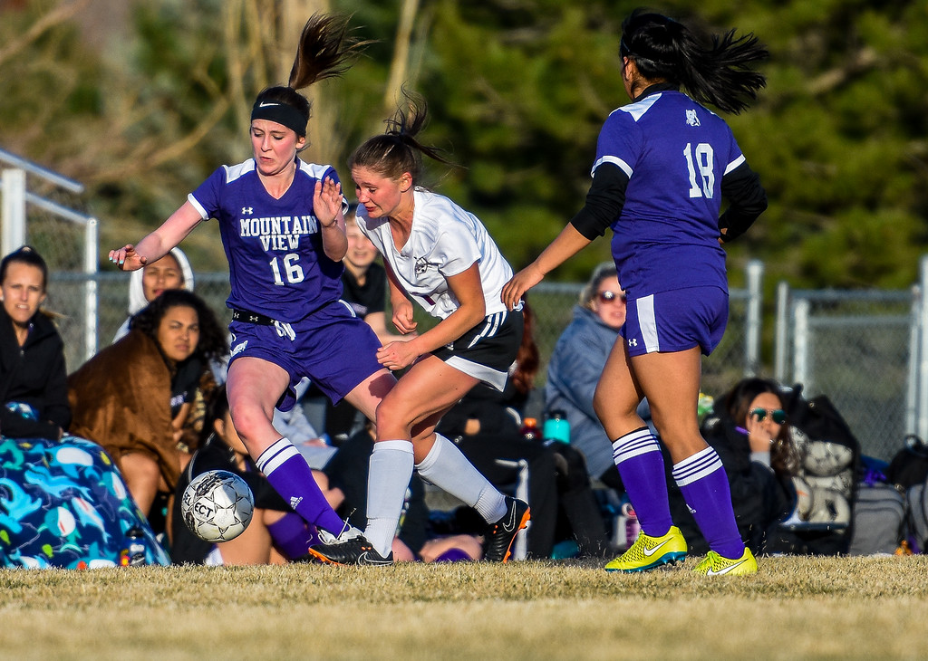 . Mountain View\'s Kaylee McKie battles for the ball with Berthoud\'s Daria Degnan on Friday March 23, 2018 at Marr Field in Berthoud. (Cris Tiller / Loveland Reporter-Herald)