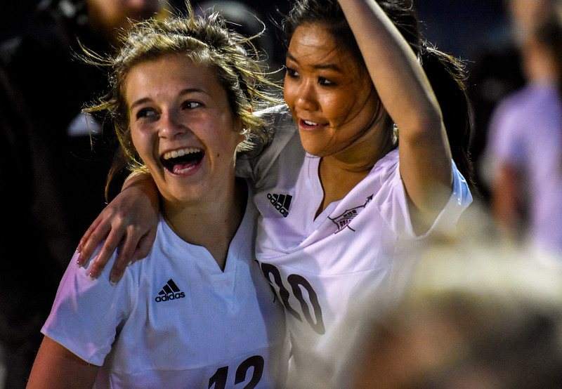 Berthoud's Maddie Barcewski, left, celebrates with teammate Lily Smith after beating Mountain View 4-2 on Friday March 23, 2018 at Marr Field in Berthoud. Barcewski scored twice in the win. (Cris Tiller / Loveland Reporter-Herald)