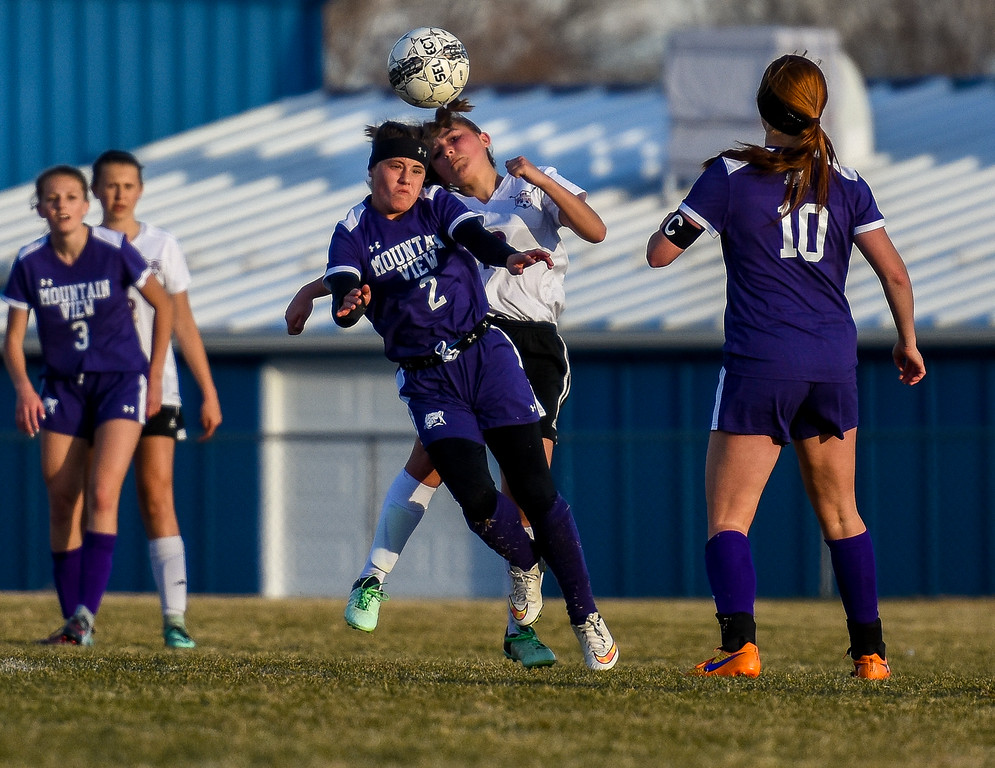 . Mountain View\'s Kaley Barker (2) goes up for a header against Berthoud on Friday March 23, 2018 at Marr Field in Berthoud. (Cris Tiller / Loveland Reporter-Herald)