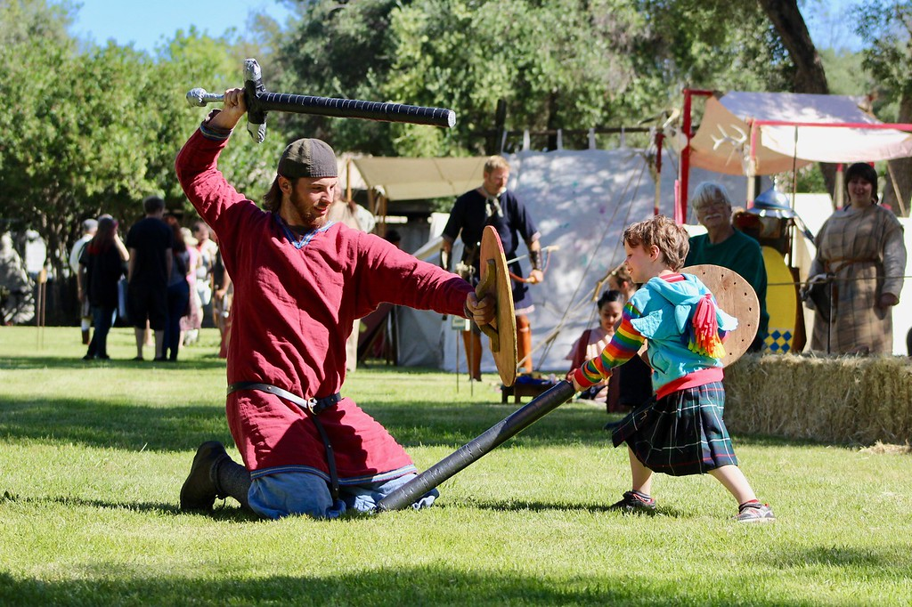 . HANS PETER - DAILY DEMOCRAT The Scottish Games allowed people to hack each other to bits (with foam swords).
