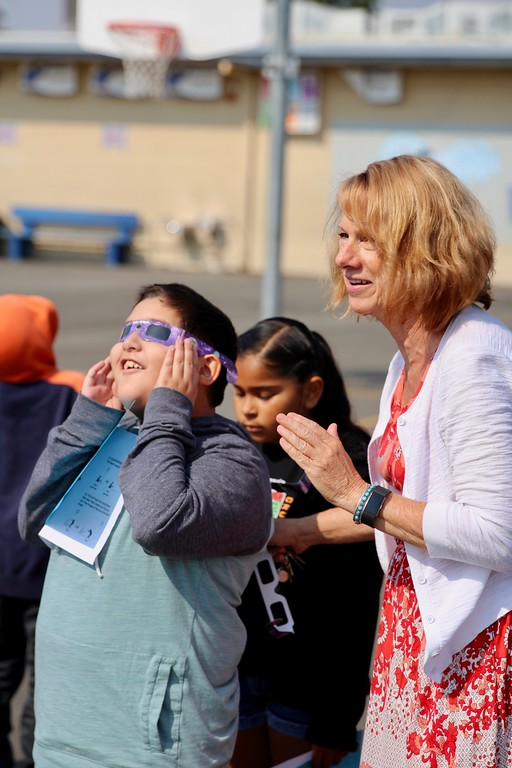 . HANS PETER - DAILY DEMOCRAT A teacher and student at Freeman Elementary gaze at the solar eclipse in August.