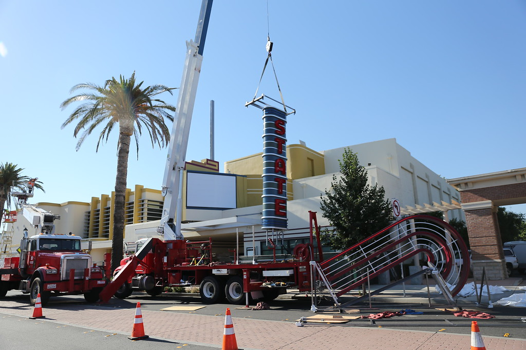 . DAILY DEMOCRAT FILE PHOTO The State Theatre sign being lifted into place on Main Street.