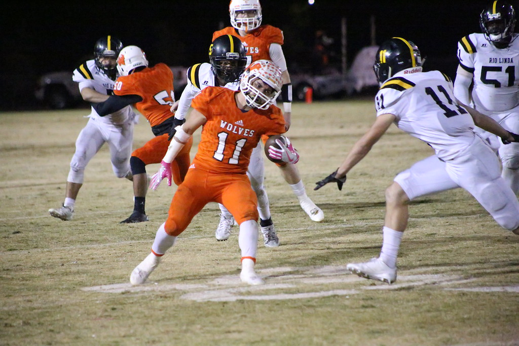 . MATT MURPHY - DAILY DEMOCRAT Woodland High running back Oscar Sanchez throws a head fake a Rio Linda defender during their game on Oct. 20. Sanchez rushed for 1,494 yards in 2017.
