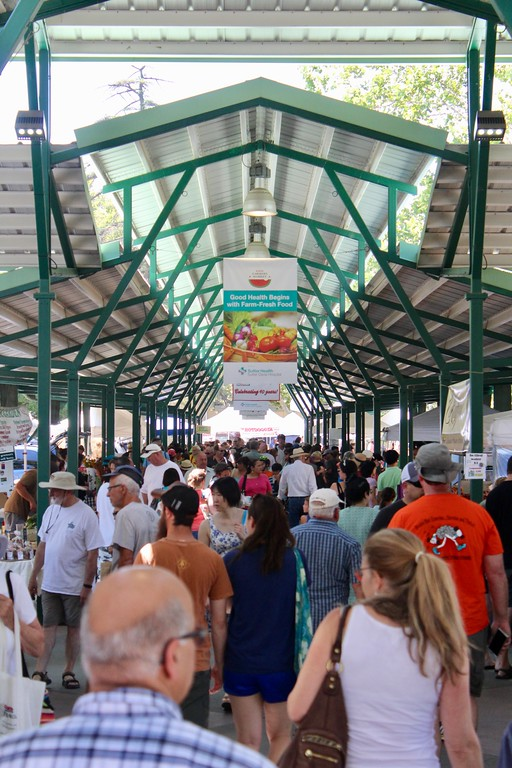 . HANS PETER - DAILY DEMOCRAT Locals peruse the Davis Farmers Market. Can you spot Supervisor Don Saylor?
