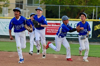 HANS PETER - DAILY DEMOCRAT A Davis Little League team celebrates a diving catch.