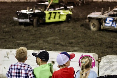 HANS PETER - DAILY DEMOCRAT Children watch cars collide at the Yolo County Fair's derby.