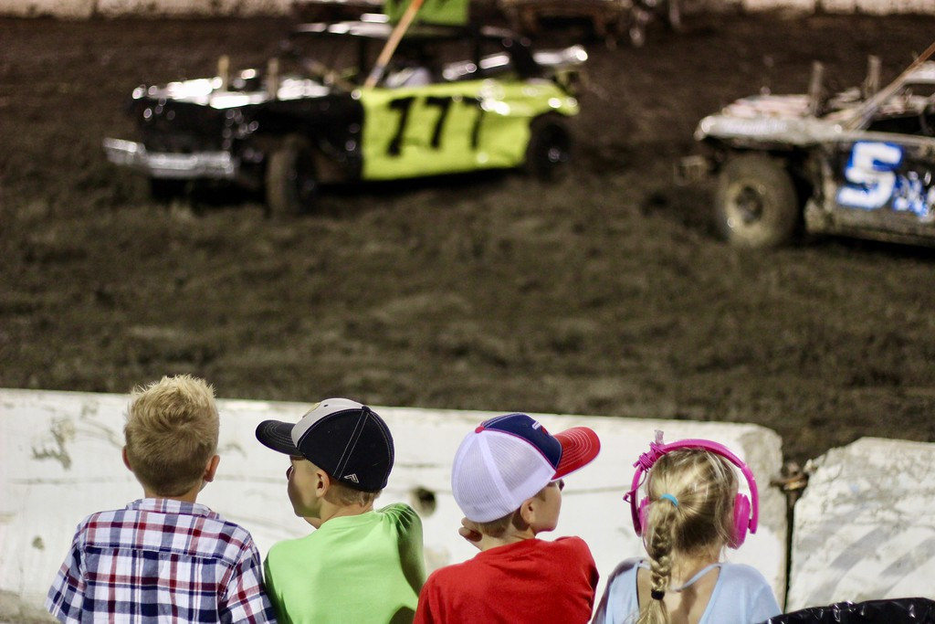 . HANS PETER - DAILY DEMOCRAT Children watch cars collide at the Yolo County Fair\'s derby.