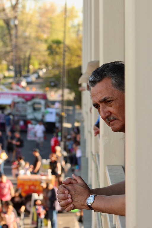 . HANS PETER - DAILY DEMOCRAT A man oversees a Food Truck Mania Sunday from the balcony at Mojo\'s Lounge.