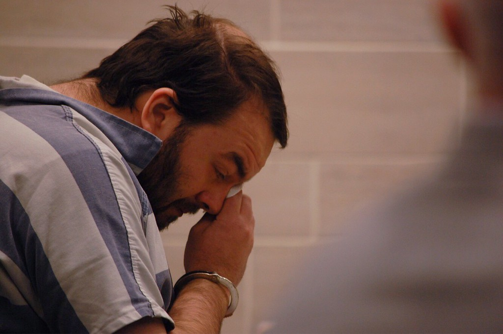 . JENICE TUPOLO - DAILY DEMOCRAT Robert Hodges wipes away tears after hearing testimony during a preliminary hearing. Hodges was accused of killing his three children and later pleaded guilty.