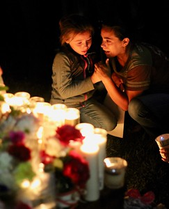HANS PETER - DAILY DEMOCRAT A woman and child mourn at a candlelight vigil on behalf of the three children who were killed in West Sacramento in September.