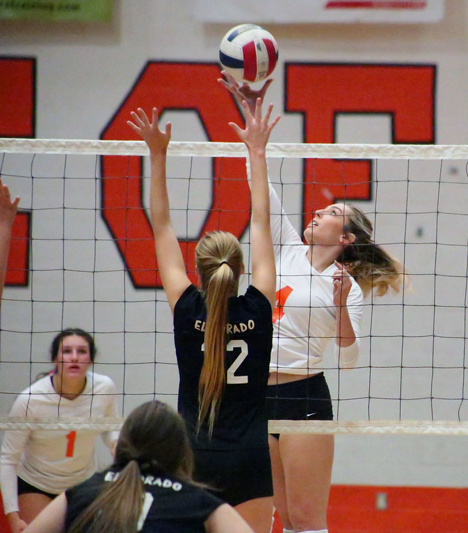 . MATT MURPHY - DAILY DEMOCRAT Woodland High\'s Jessica Baker taps the ball over two El Dorado defenders during their second round playoff game on Nov. 2.