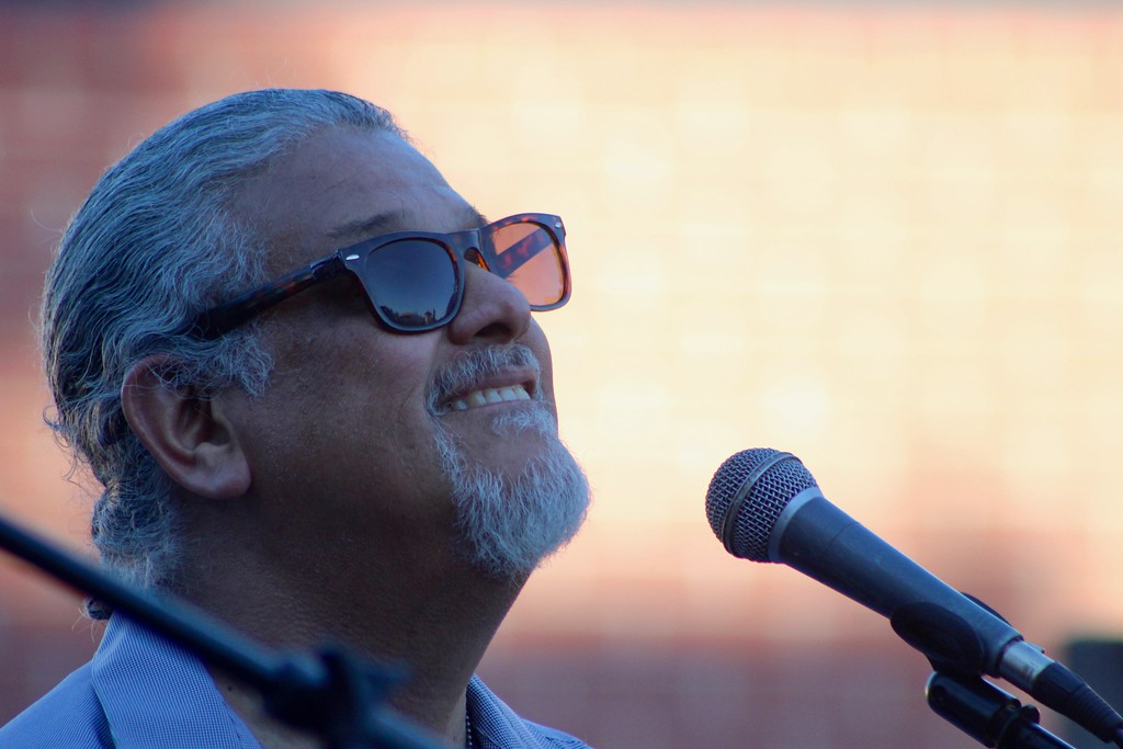 . HANS PETER - DAILY DEMOCRAT Vocalist Ted Vega of Salsa band Conjunto Liberacion kept dancers on their feet during a Thursday Night Live at the Plaza concert.