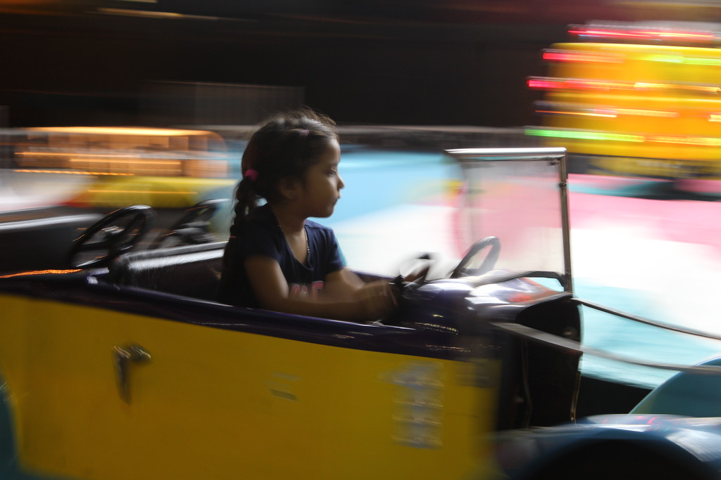 . HANS PETER - DAILY DEMOCRAT A child whirs around at the Yolo County Fair.