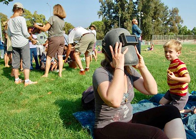 JENICE TUPOLO - DAILY DEMOCRAT Spectators gather to watch the summer solar eclipse.