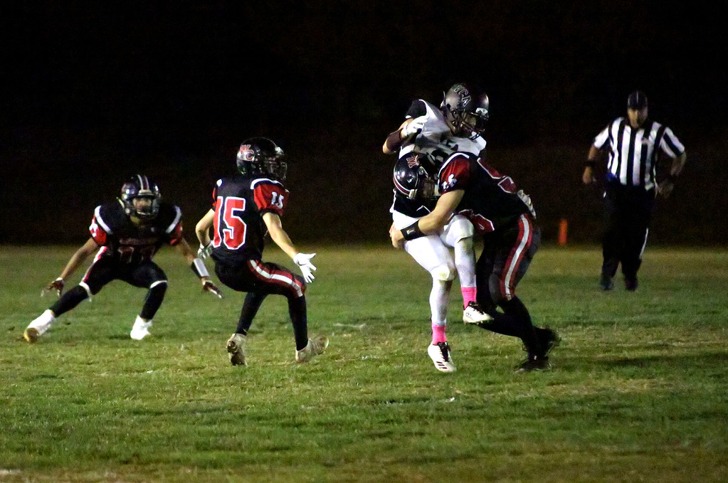 . MATT MURPHY - DAILY DEMOCRAT Woodland Christian linebacker Will Black levels a Valley Christian Academy receiver during their game on Oct. 6.